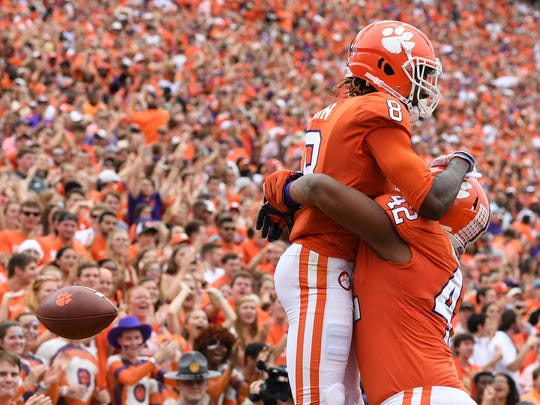Clemson wide receiver Deon Cain (8) celebrates with defensive lineman Christian Wilkins (42) after catching a TD against Wake Forest during the 1st quarter on Saturday, October 7, 2017 at Clemson's Memorial Stadium.