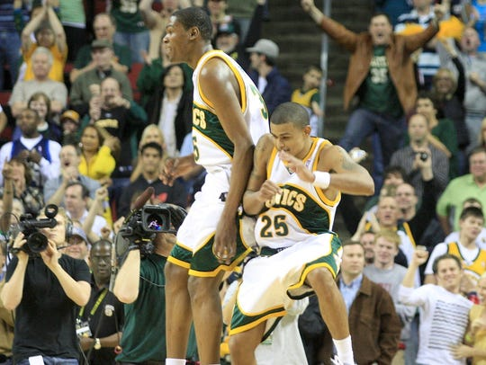 Kevin Durant and Earl Watson celebrate during the Seattle SuperSonics' last game at KeyArena, on April 13, 2008.