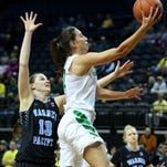 Oregon guard Maite Cazorla (4) drives to the basket for a lay up past Warner Pacific forward Lindsay Loe (13) during an exhibition game inside Matthew Knight Arena, Wednesday, November 11, 2015, at the University of Oregon in Eugene, Ore.