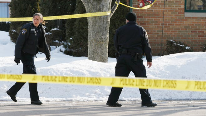 Manitowoc police at the scene of the Feb. 5, 2016, shooting death of 52-year-old Kor Yang.