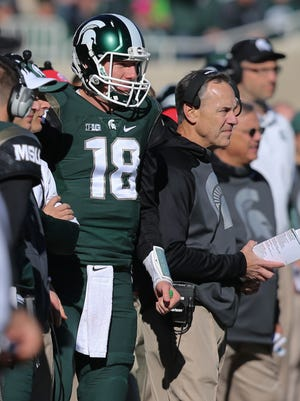 Michigan State football coach Mark Dantonio, right, and quarterback Connor Cook look on against the Maryland Terrapins on Saturday, Nov. 14, 2015, at Spartan Stadium in East Lansing.