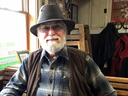 In this Tuesday, March 28, 2017, photo, retiree Robert Gillesse, poses for a photo in Lowell, Mich., as he discusses his views on President Donald Trump and the congressman representing his district, Rep. Justin Amash, R-Mich. Defying President Donald Trump on the Republican Party's promise to repeal and replace Obamacare sounds like political suicide, especially in the congressional districts Trump won handily. But some Republicans who blocked the legislation won praise from constituents for stopping what many saw as a flawed plan, either in the legislation's substance or strategy. (AP Photo/Chris Ehrmann)