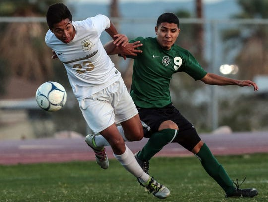 Desert Hot Springs' Zeus Rico fights for the ball with