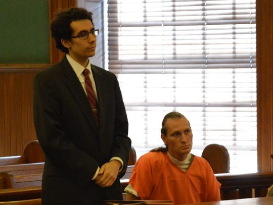 Tobias Rundstrom-Wooding appears with defense lawyer