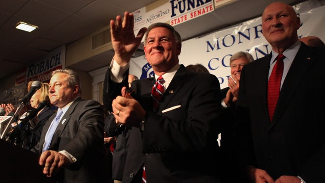 Republican Rich Funke celebrates with fellow Republicans on election night.