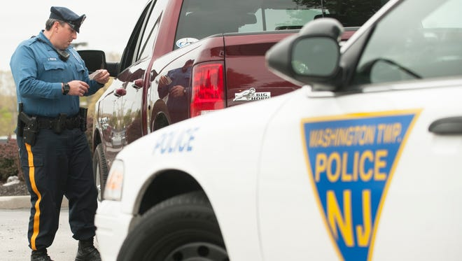 Washington Township Police Officer John Freitag pulls over a motorist for using a hand-held cell phone while driving on Black Horse Pike near Greentree Road as Officer Freitag patrols the area as part of the township's Data-Driven Approaches to Crime and Traffic Safety (DDACTS) program.  04.28.16