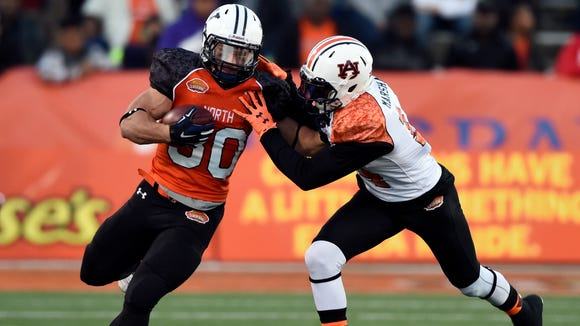 Jan 24, 2015; Mobile, AL, USA; North squad fullback Tyler Varga of Yale (30) carries up the field against South squad defensive corner Nick Marshall of Auburn (14) during the third quarter of the Senior Bowl at Ladd-Peebles Stadium. The North squad defeated the South squad 34-13. Mandatory Credit: John David Mercer-USA TODAY Sports