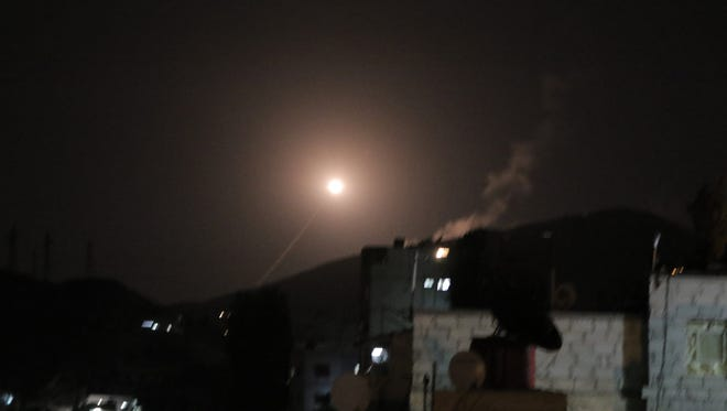 A missile from the air defenses belonging to the Syrian Arab Air Force attempts to intercept a coalition missile in the skies of Damascus, Syria