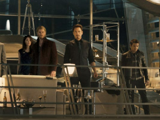 """This photo provided by Disney/Marvel shows from left, Cobie Smulders as  Maria Hill, Chris Evans as Steve Rogers/Captain America, Don Cheadle as James """"Rhodey"""" Rhodes/War Machine, Claudia Kim as  Dr. Cho,  Chris Hemsworth as Thor, Robert Downey Jr. as Tony Stark/Iron Man, Jeremy Renner as Clint Barton/Hawkeye, Mark Ruffalo as Bruce Banner/Hulk, and Scarlett Johansson as Natasha Romanoff/Black Widow, in a scene from the new film, """"Avengers: Age Of Ultron."""" """"Avengers: Age of Ultron"""" debuted with a Hulk-sized 27.6 million in Thursday night showings, well above the pace of the first """"Avengers"""" film. Disney said Friday that the opening night haul of """"Age of Ultron"""" easily surpassed the 18.7 million first night opening of """"The Avengers"""" in 2012."""