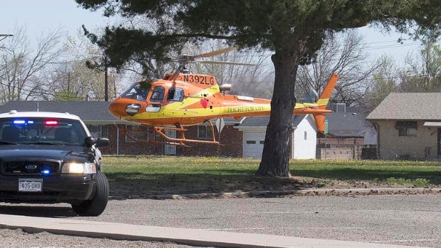 [CHIEFTAIN FILE PHOTO] A Flight for Life helicopter lands on an open area along Hollywood Boulevard next to South High School during a mock DUI accident drill on April 26, 2018. Authorities would like to see the chopper grounded this weekend and not have to respond to a DUI crash.