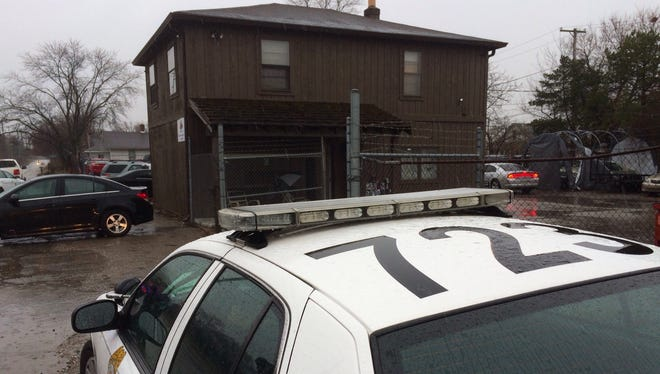 Police raid a Bluff Road business on Tuesday, March 1, 2016.