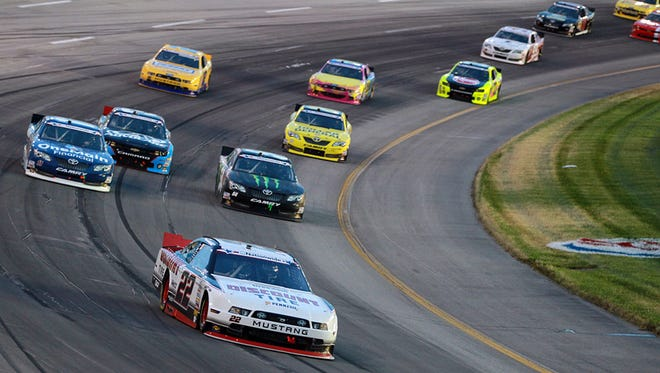 Brad Keselowski (No. 22) leads the pack in the NASCAR Nationwide Series race at Kentucky Speedway in 2013.