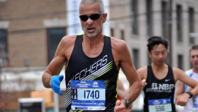 Fred Zalokar runs during the 2015 New York Marathon, one of five World Marathon Major age group titles he's won.