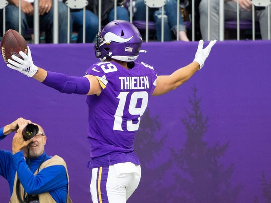 Minnesota Vikings wide receiver Adam Thielen (19) scores in the first quarter against Oakland Raiders at U.S. Bank Stadium. Brad Rempel-USA TODAY Sports