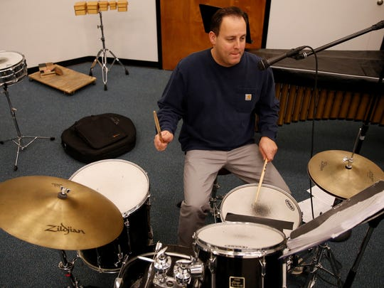 San Juan College music professor Tuen Fetz is the founder and drummer for the Mardi Gras band Funkified.