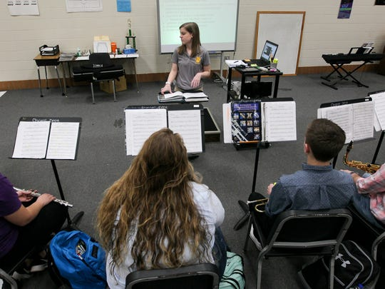 Katy Buis directs Crescent High School band practice Tuesday..