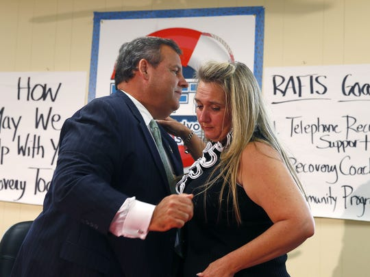 Gov. Chris Christie shares a hug with Michele Perez from City of Angels during a stop at the Manasquan Recreation Annex Thursday, September 21, 2017. He was there for a roundtable discussion with parents of recovering addicts.