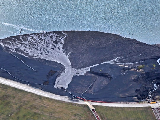 This is Duke's Cayuga Generating Station along the Wabash river, as seen from the air, Thursday, Sept. 7, 2017.  This is a coal ash pit.