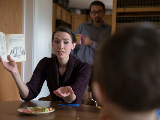 Rachael Denhollander reads to her three children as her husband Jacob watches, during family lunchtime, Louisville, Tuesday, Jan. 31, 2017. Denhollander's interview with IndyStar in August 2016 set into motion a series of events and court trials that resulted in the imprisonment of doctor Larry Nassar, the resignation of the Michigan State University President, and  changes to the USAG Board of Directors.