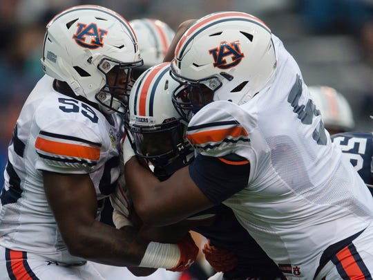 Auburn defensive linemen T.D. Moultry (55) and Derrick Brown (5) make a tackle on A-Day.