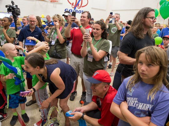 People gather to photograph loved ones, and Indianapolis Mayor Joe Hogsett have hair shaved off at Jack Klein day, an event raising money for childhood cancer to honor Klein, a local boy who died in from the disease, Indianapolis, Saturday, June 2, 2018. The head-shaving event is coupled with St. Baldrick's Foundation.
