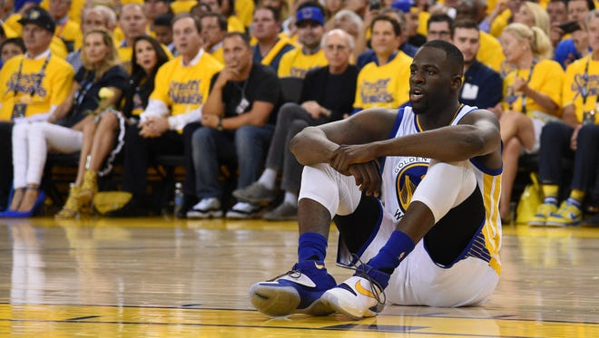 Draymond Green reacts against the Oklahoma City Thunder during the fourth quarter in game one of the Western conference finals of the NBA Playoffs at Oracle Arena.