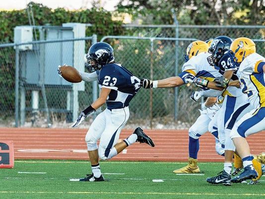 File photo — The Daily Times Piedra Vista's Matt Gonzales scores during a game on Aug. 28 against San Juan High School at Hutchison Stadium in Farmington.