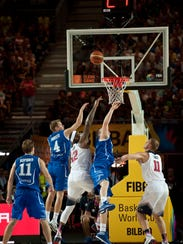 United States's DeMarcus Cousins third left, tries to dunk  between Finland's Mikko Koivisto, left, during the Group C Basketball World Cup match between United States and Finland,  in Bilbao northern Spain, Saturday, Aug. 30, 2014. The 2014 Basketball World Cup competition will take place in various cities in Spain from Aug. 30 through to Sept. 14. (AP Photo/Alvaro Barrientos)