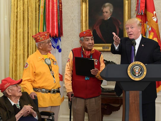 President Donald Trump (right) speaks during a meeting