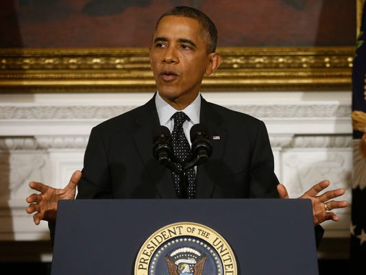 Obama signs bill to pay military death benefits