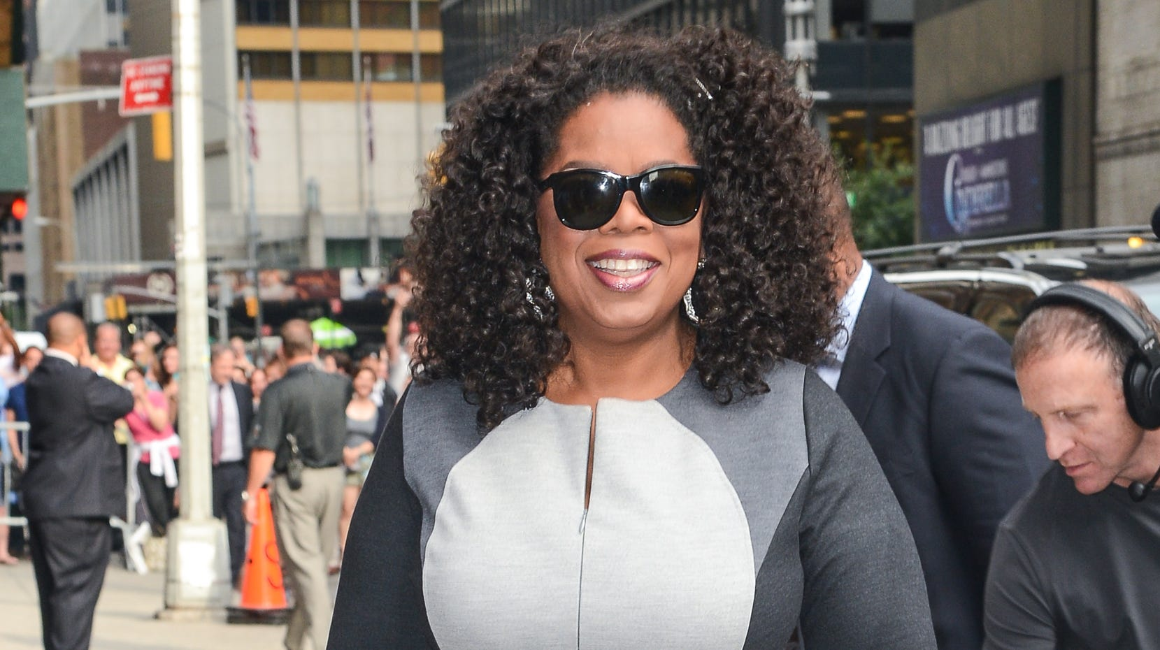 Oprah tries out the colorblocking trend in a multi-toned gray frock as she makes her way into the studio for a taping of the 'Late Show With David Letterman' on July 31.
