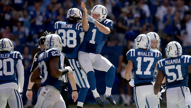 Pat McAfee celebrates his onside kick with Sergio Brown in the first quarter.