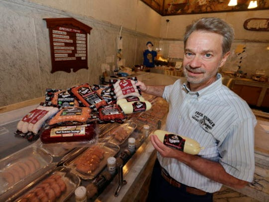 Fritz Usinger shows off some favorites at the Usinger's Sausage gift shop. Usinger's meats will be available in the hospitality tents at the U.S. Open.