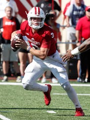 Indiana Hoosiers Peyton Ramsey (3) scrambles out of