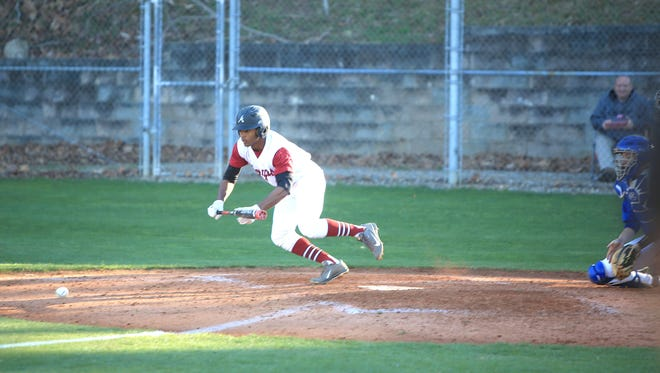 Asheville High senior Devin Mangum lays down a bunt during a recent nonconference game against West Henderson.
