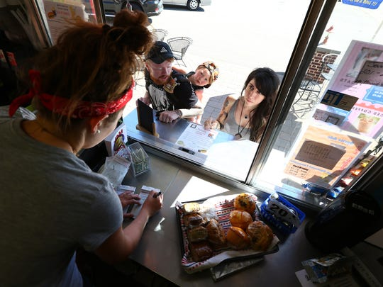 Gina Lombardo takes an order from Christopher, l, Isaac