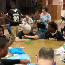 Football players visited and played games with residents of the Magnolia School.