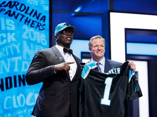 Vernon Butler (Louisiana Tech) with NFL commissioner Roger Goodell after being selected by the Carolina Panthers as the number thirty overall pick in the first round of the 2016 NFL Draft at Auditorium Theatre.