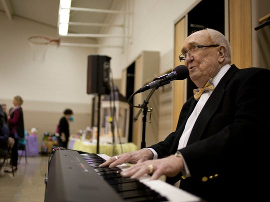 Johnny Needham, of Port Huron, sings and plays piano