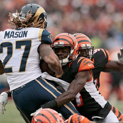 St. Louis Rams running back Tre Mason (27) is brought