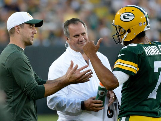 Green Bay Packers quarterback Aaron Rodgers advises  quarterback Brett Hundley (7) during the two-minute warning of the first half of a preseason game between the Green Bay Packers and the New Orleans Saints at Lambeau Field in Green Bay, Wis. on Thursday, Sept. 3, 2015.