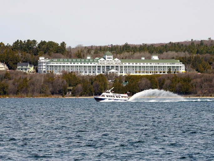The Star Line ferry zooms past the Grand Hotel perched