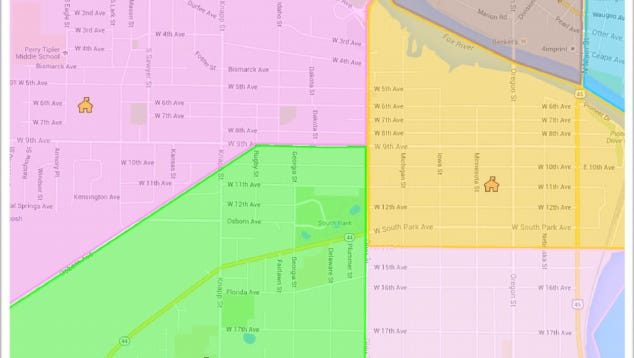 A map shows the proposed change to an Oshkosh Area School District boundary along Ohio Street. The current boundary is drawn a half block to the east and divides the 500 block of Fifth Avenue through 20th Avenue