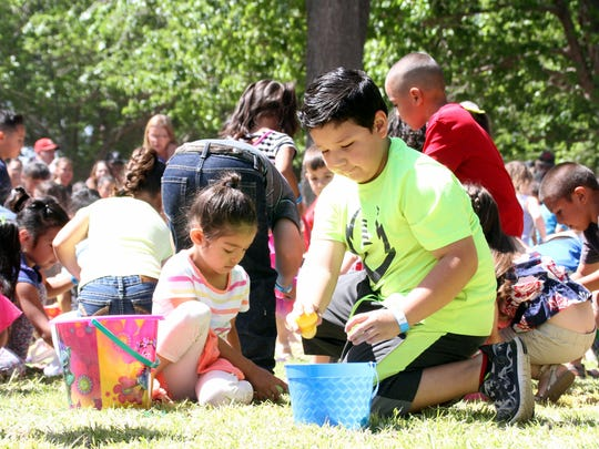 Children in the 4 to 6 age group scrambled for the pastel-colored plastic eggs on Saturday. Over 30,000 eggs were tossed abut Luna County Courthouse Park.