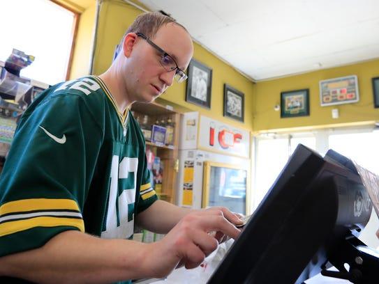 Owner Jared Mason rings up a customer at the Mason