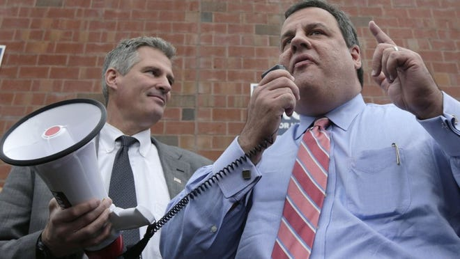 Gov. Chris Christie, right, is flanked by U.S. Sen. Scott Brown, as he talks to supporters at a campaign stop for Brown in Watertown, Massachusetts, on Oct. 24, 2012. Brown hosts a house party for Christie in New Hampshire tonight. (Charles Krupa/AP)