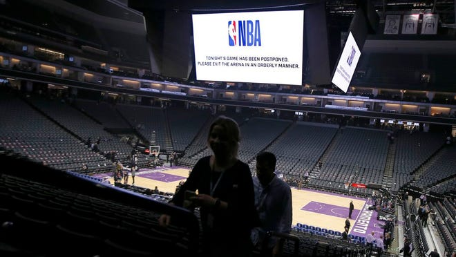 "From March 11, 2020, fans leave the Golden 1 Center  in Sacramento, Calif., after the NBA basketball game between the New Orleans Pelicans and Sacramento Kings was postponed at the last minute over an ""abundance of caution"" after a player for the Jazz tested positive for the coronavirus.  A person with knowledge of the situation says NBA players will be allowed to return to team training facilities starting Friday, May 1 provided that their local governments do not have a stay-at-home order prohibiting such movement."