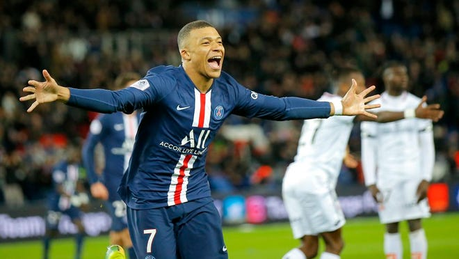 Feb.29, 2020, PSG's Kylian Mbappe celebrates after scoring his side's fourth goal during the French League One soccer match between Paris-Saint-Germain and Dijon, at the Parc des Princes stadium in Paris. Paris Saint-Germain has been declared French league champion after the soccer season ended early because of the coronavirus pandemic.