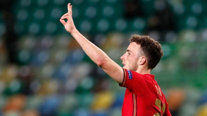 Portugal's Diogo Jota celebrates after scoring his side's second goal during the UEFA Nations League soccer match between Portugal and Sweden at the Jose Alvalade stadium in Lisbon, Portugal, Wednesday, Oct. 14, 2020.