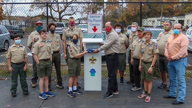 Members of Boy Scout Troop One of Hot Springs met with representatives from the City of Hot Springs and Garland County at the unveiling of the new Flag Retirement Drop Box on Nov. 9, 2020. Pictured, from left, Teddy Headler, Dustin Terrill, Aaron Humphrey, William Pumphrey, Mason McElrath, Sawyer Headley, City Manager Bill Burrough, Clayton Hardister, Larry Nieman, Cubby McElrath, Isaac Booth, Jay Hardister and Garland County Judge Darryl Mahoney.